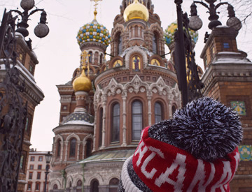 Student wearing Canada toque standing in front of Church of the savior of blood