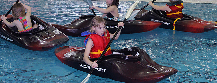 Sport and Wellness Aquatics Youth Camps Banner Photo of Kids Kayaking