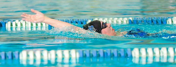 Sport and Wellness Public Swimming Photo of Person Lane Swimming