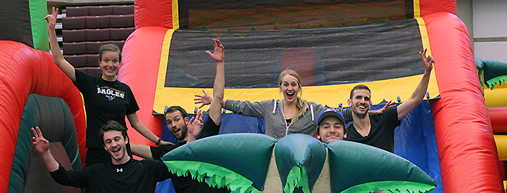 Sport and Wellness Special Events Banner Photo of People in Bouncy Castle