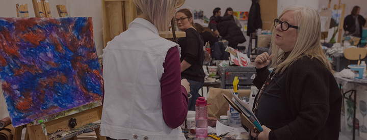 Fine Art student teacher interaction painting studio