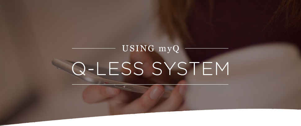 """Using myQ Q-less system"" student holding mobile phone"