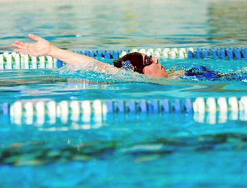 Woman swimming in MacEwan pool