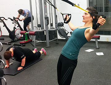 Woman on TRX in gym