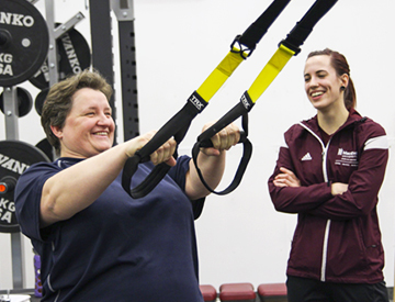 Sport and Wellness Personal Training Feature Image Photo of Person and Trainer in Gym