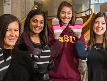 Students wearing mittens