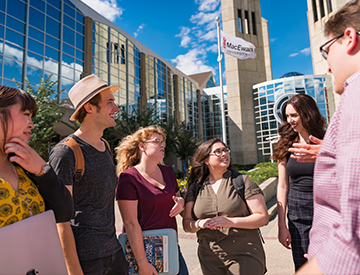 Students in summer talking outside MacEwan